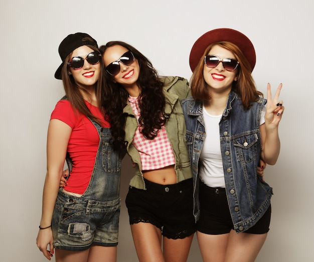 Three stylish sexy hipster girls best friends.
