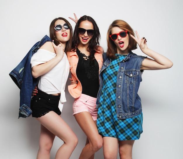 Three stylish sexy hipster girls best friends