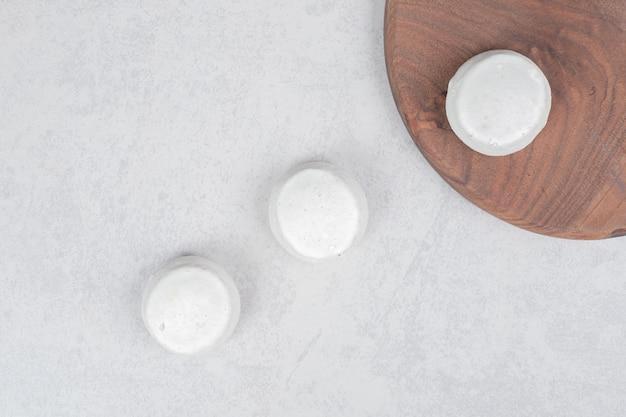Three sweet cookies on wooden board