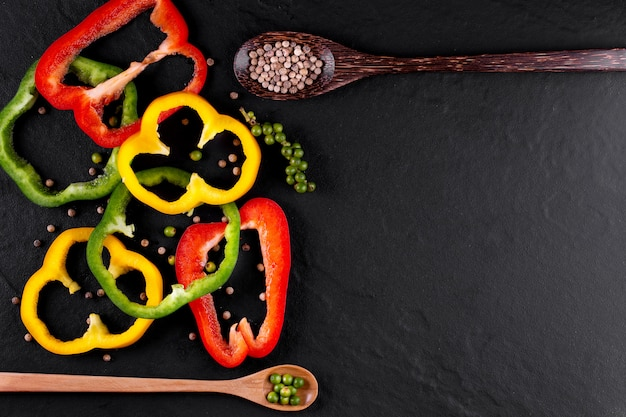 Three sweet peppers on a wooden background, cooking vegetable salad