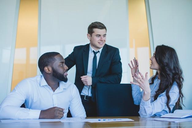 Three talking associates