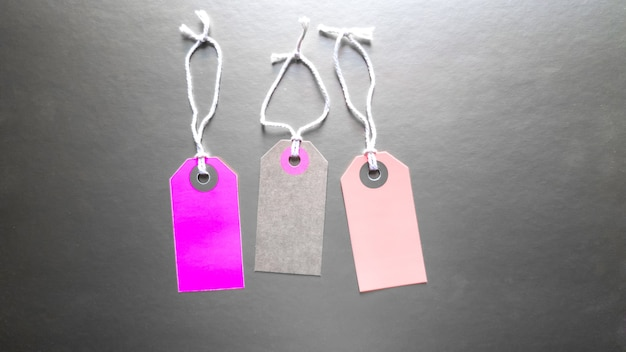 Three trendy mockup labels with clothes. clothes sale. background for the holiday black friday is an international day of shopping, stocks, discounts, sales. three tags with clothes.