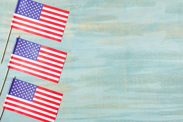 Three usa flags on colored textured background