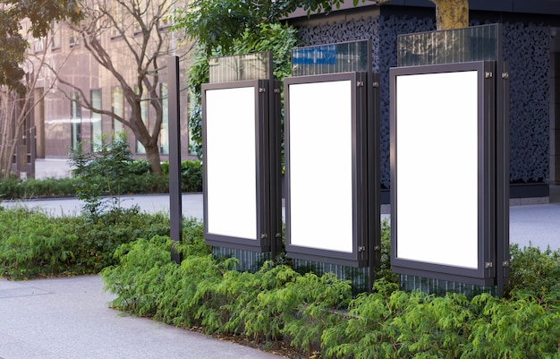 Three vertical billboards on the city streets