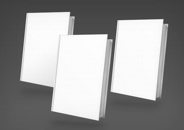 暗い背景の上の3つの白い本の構成