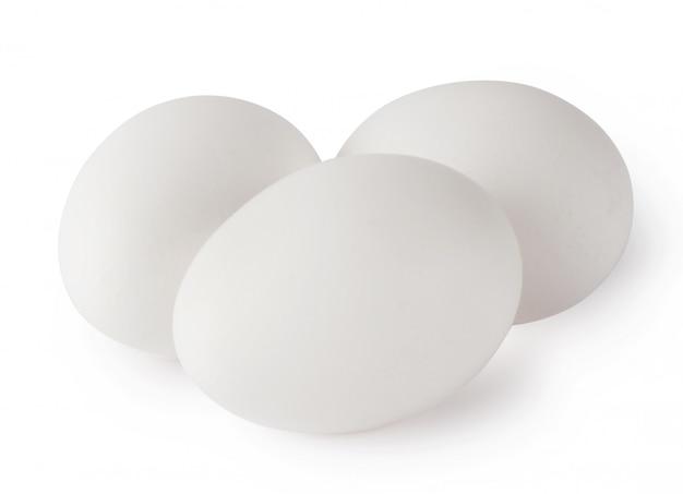 Three white chicken eggs