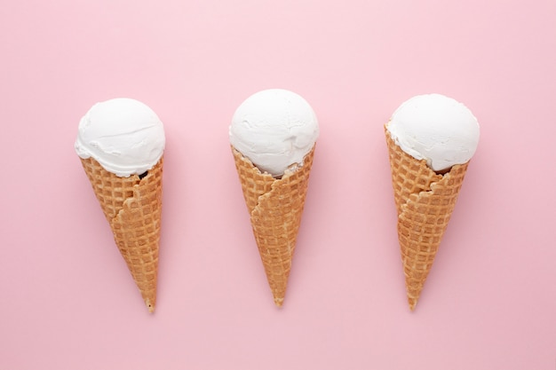 Three white ice creams on table