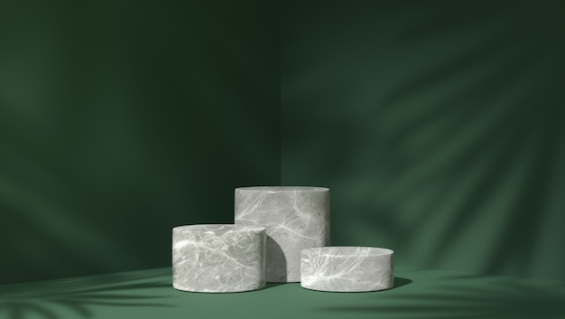 Three white marble cylinder podium for product placement in shadow leaves background