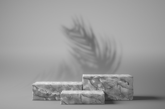 Three white marbles are graduated in a white setting with tree shadows in the background stag