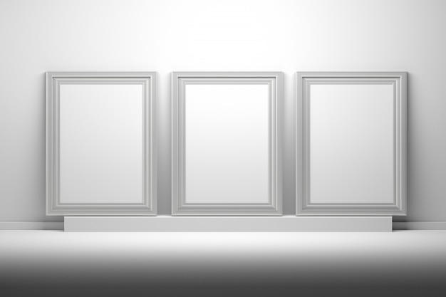 Three white picture frames for presentation mockups with blank copy space standing on pedestal.