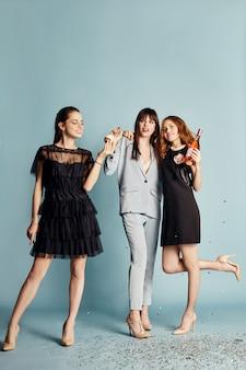 Three women celebrate the holiday having fun