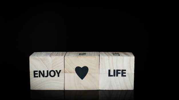 Three wooden cubes - enjoy life