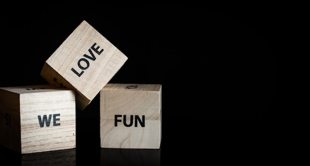 Three wooden cubes - we love fun