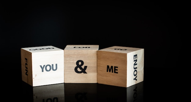 Three wooden cubes - you and me