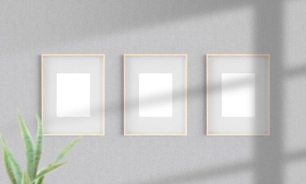 Three wooden frames on a wall mockup 3d rendering