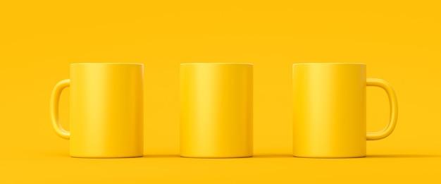 Три желтые кофейные чашки или пустая кружка для напитка на ярком цветном фоне