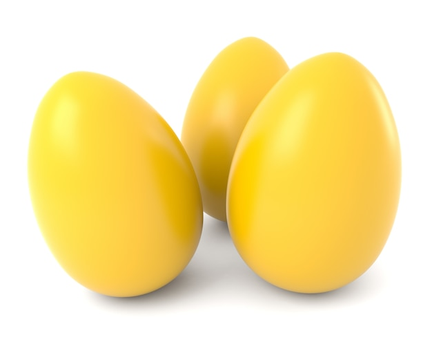Three yellow eggs isolated on white background