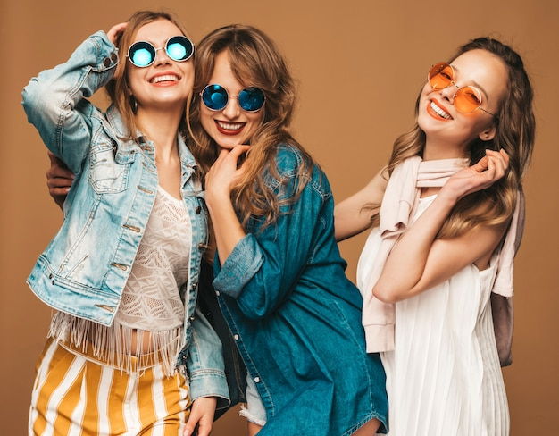 Three young beautiful smiling girls in trendy summer casual clothes. sexy carefree women posing. positive models.