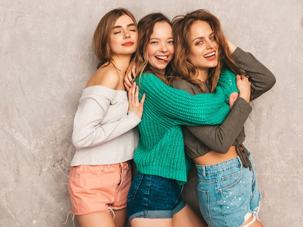Three young beautiful smiling gorgeous girls in trendy summer clothes.  sexy carefree women posing. positive models having fun