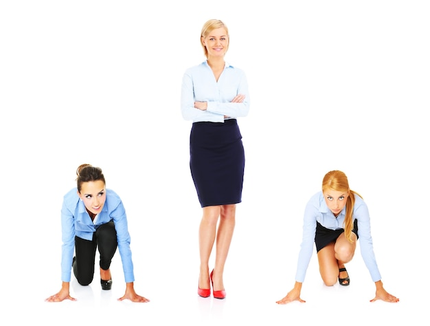Three young businesswoman making competition over white background