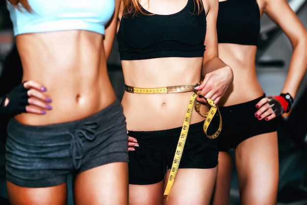 Three young girls workout in the gym