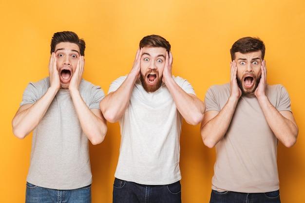 Three young shocked men screaming