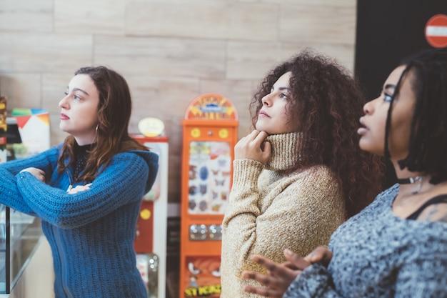 Three young women staring