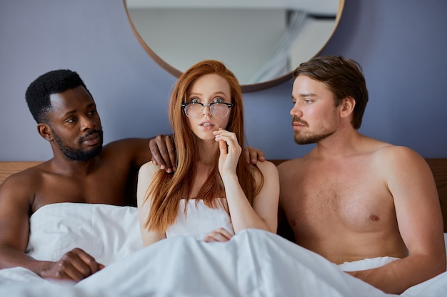 Threesome concept with people going to have group sex together