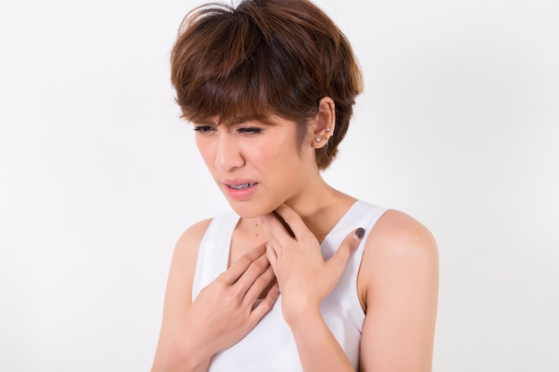 Throat pain. woman with sore throat feeling bad. beautiful young asian girl touching neck with hand. concept for healthy and medical