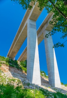 Through the kravice national park in bosnia and herzegovina there is a long modern bridge.