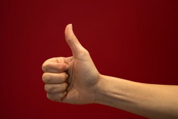 Thumb up sign with hand