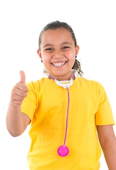 Thumb up young girl with a toy stethoscope