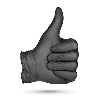 親指を立てるサイン。白い背景で隔離の黒いニトリル手袋を手に。