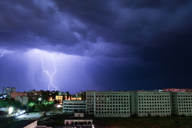 Thunderbolt over the house. storm outside.
