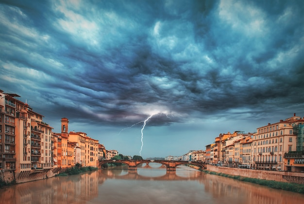 Thunderstorm on the arno river in florence