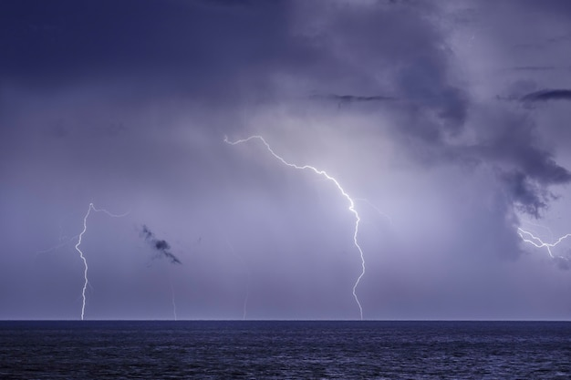 Thunderstorm over the sea,lightning beats the water