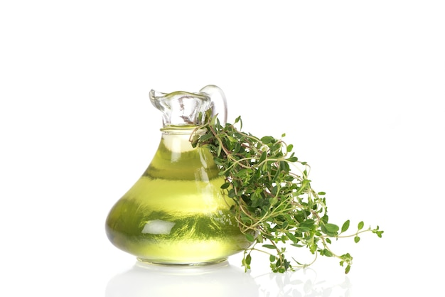 Thyme branch green leaves and oil isolated on white background.