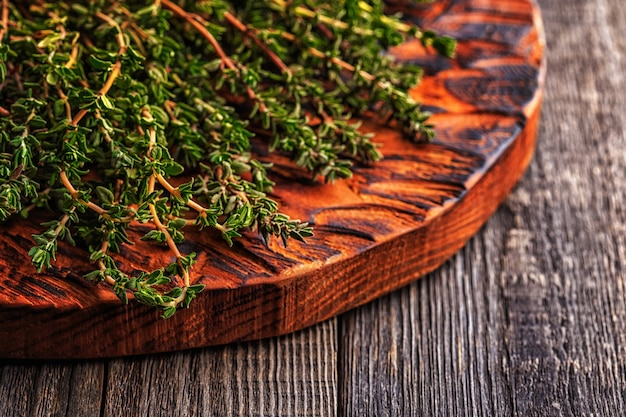 Thyme on old wooden board