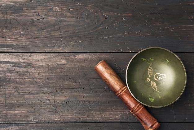 Медная поющая тибетская чаша с деревянной колотушкой