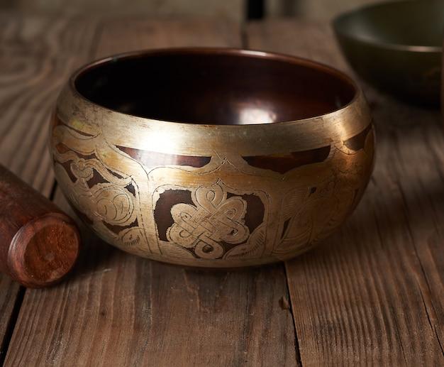 Тибетская поющая медная чаша с деревянной трещоткой
