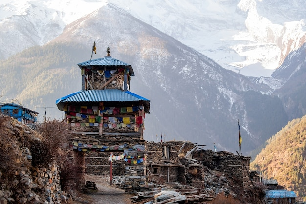 Tibetan village in himalaya mountains in the morning with snowy peak