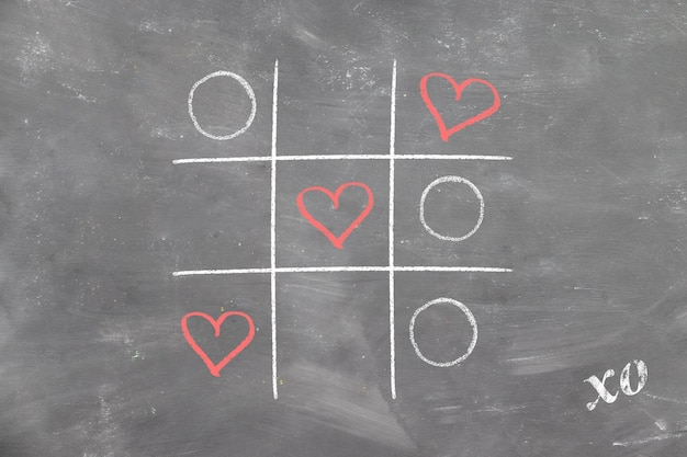 Tic-tac-toe on chalk board won love hearts and valentine's day signed xo