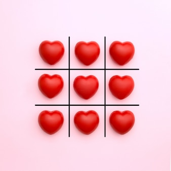 Tick tack toe made from red heart on pink background. valentine's day concept. minimal style.