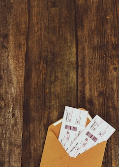 Tickets on wooden background