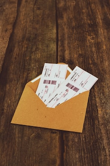 Tickets on wooden table