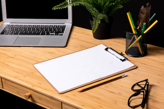 Tidy desk with clipboard and glasses