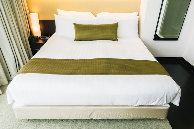 Tidy hotel room with golden cushion