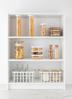 Tidy up concept with foodstuff on shelves