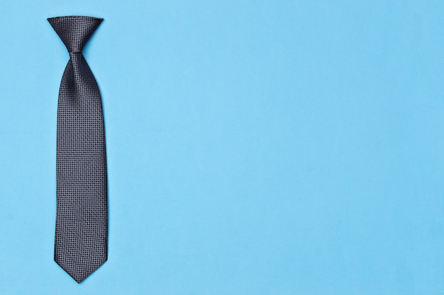 Tie on blue surface