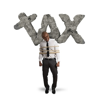 Tied businessman is crushed and oppressed by weight taxes